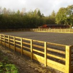 Outdoor_horse_arena_with_posts_and_rail_fencing