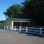Outdoor_horse_arena_with_large_storge_barn