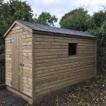 shed_with_small_window_shingle_tiled_roof
