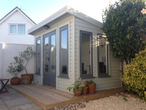 painted_summerhouse_with_decking